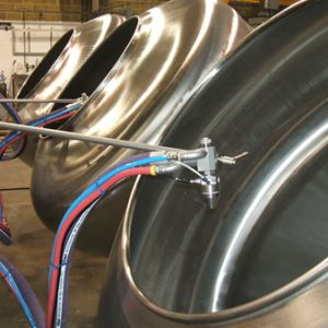 Coating pans for tumble coating. Variable speed.