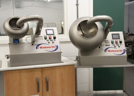 Laboratory scale coating pans. Manual additions and loading, discharge. Baffles optional