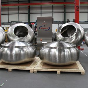 Coating pan for tumble coating, variable speed, baffles, 60 inch. Complex baffle option. Interchangeable spare pans. Pharmaceutical application.