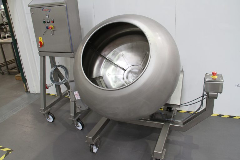 Coating pan for tumble coating. Variable speed, baffles. 40 inch. Side outlet valve.